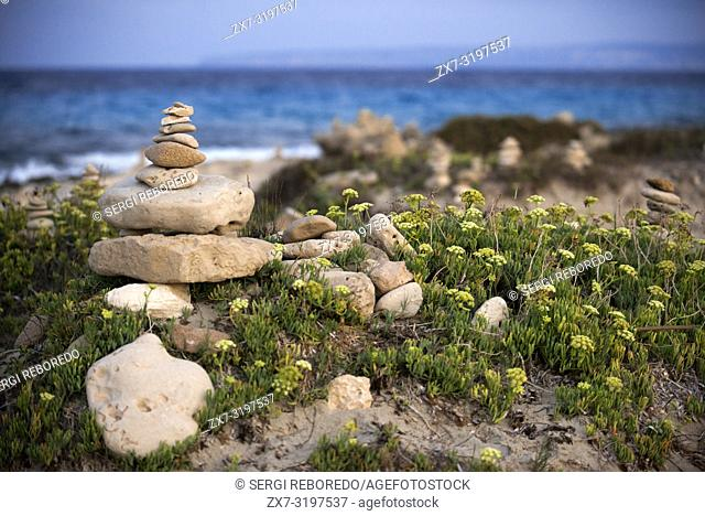 Zen space. Stones. Ses Illetes Beach, Balearic Islands, Formentera, Spain. Backlights in the sunset with stones with different shapes