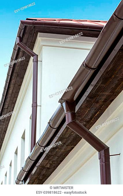 Roof detail - modern gutter and pipes