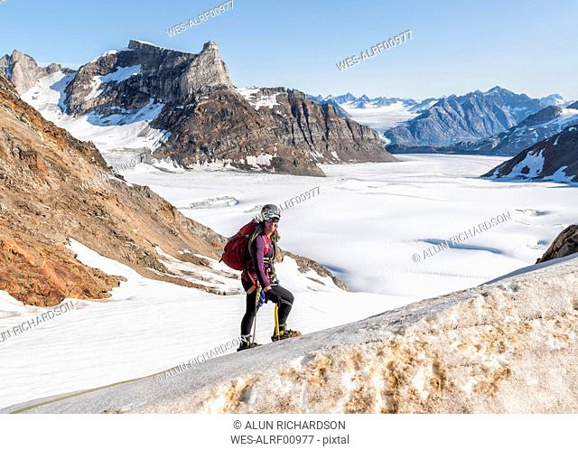 Greenland, Sermersooq, Kulusuk, Schweizerland Alps, portrait of smiling mountaineer in snow