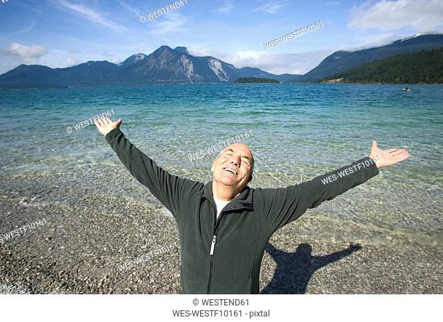 Germany, Bavaria, Walchensee, Senior man cheering