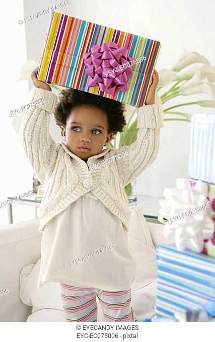 African American child holding birthday present
