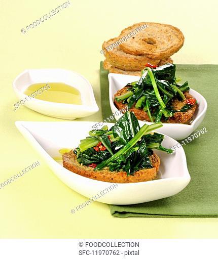 Friselle con le cime di rapa (bread crisps with steamed rapini, Italy)