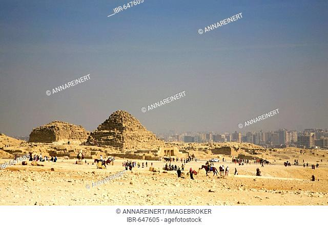 Pyramid with view of Cairo in background, Giza, Egypt, North Africa, Africa