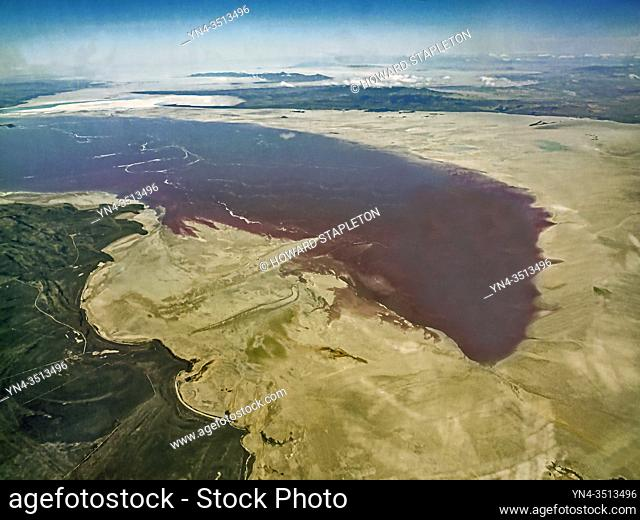 An aerial veiw of a portion of the Great Salt Lake in Utah. Color in the water is caused by algae