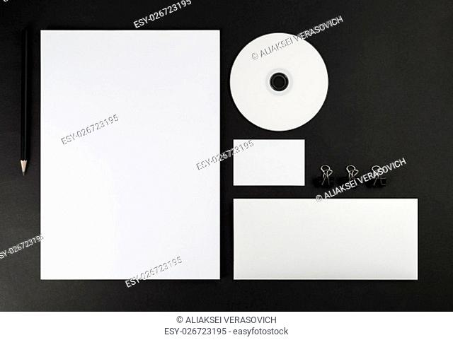 Corporate identity template on black background. Top view