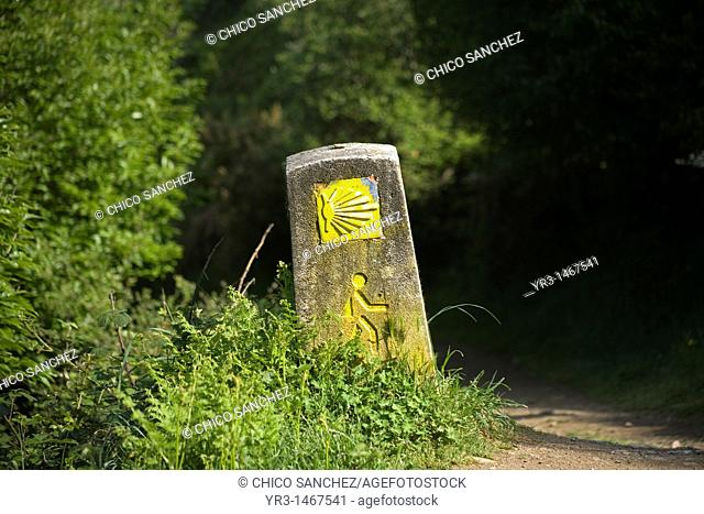 A boundary stone decorated with a drawing of a human body is displayed in the French Way that leads to Santiago, El Bierzo region, Spain
