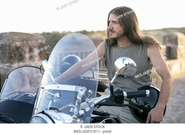 Portrait of man on his sidecar motorcycle
