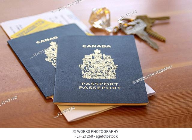 Two Canadian passports with key fob and documents
