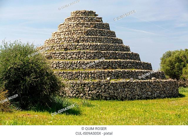 View of circular stepped ancient Talayotic building, Menorca, Spain