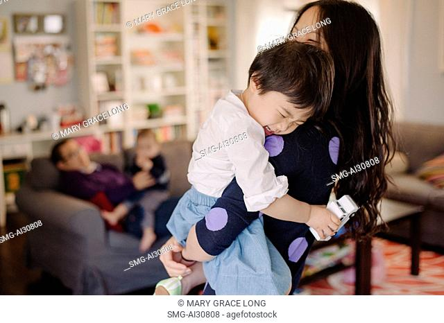 USA, Young woman laughing with daughter (2-3)
