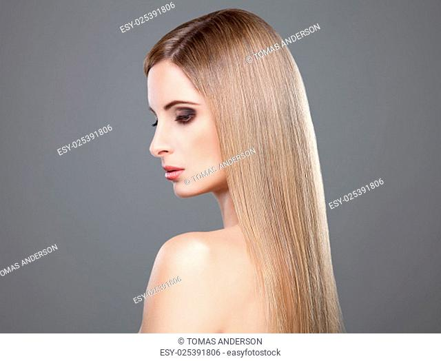 Profile of a beauty with long straight blonde hair