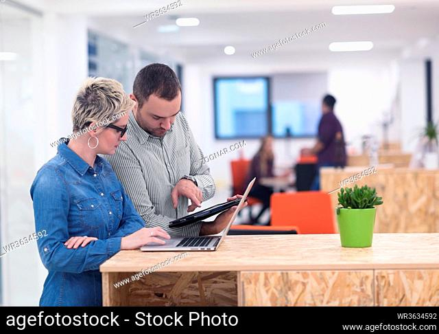 startup business team on meeting in modern bright office interior brainstorming, working on laptop and tablet computer
