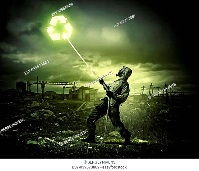 Man in respirator against nuclear background. Recycle concept