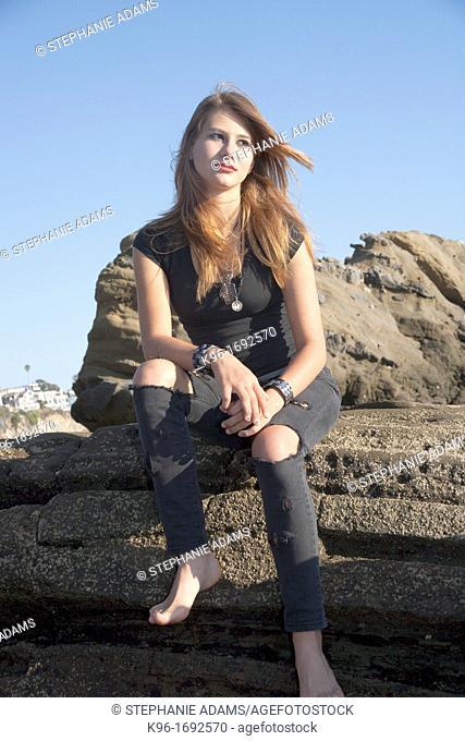 teenage girl on rocks