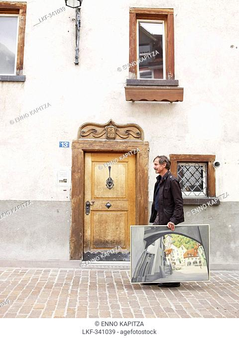 Man carrying painting, Chur, Canton of Grisons, Switzerland