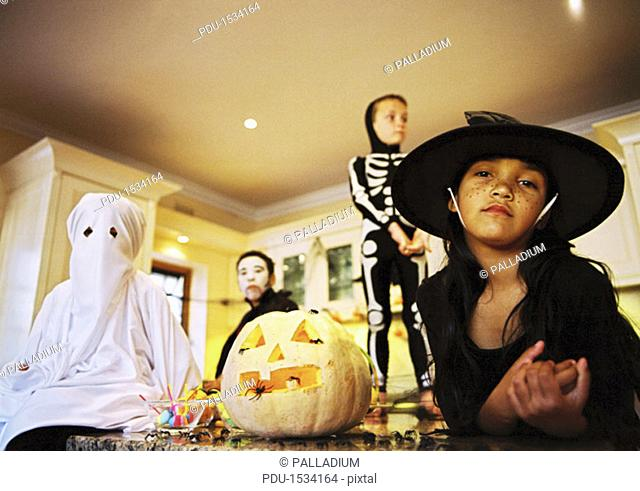 low angle view of a group of children dressed in Halloween costumes