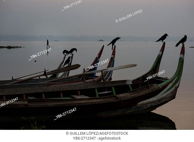 Long tail wooden boats moored at the Taungthaman Lake, Amarapura, Myanmar