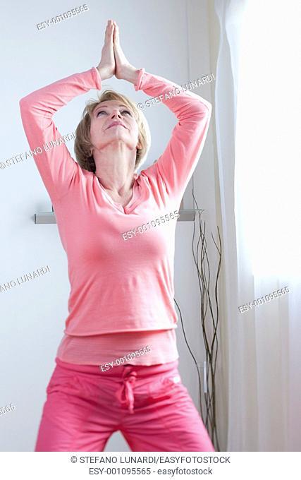 Mature Woman doing yoga exercises