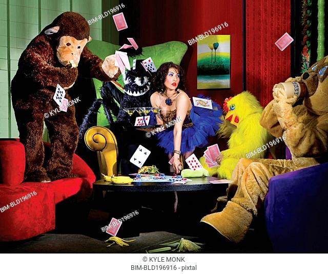 People in animal costumes playing poker