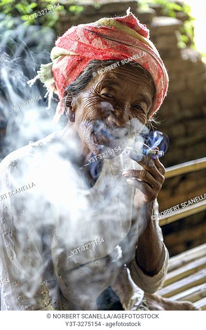 Myanmar (ex Birmanie). Inle lake. Old woman smoking the cheroot the Burmese cigar