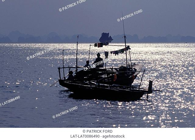 Sea. Dusk,sunset. Grey light. Silhouette of fishing boat,houseboat. Three people. Seas & skiesFishingSunset,night,dawn