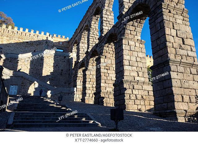 Late afternoon shadows created by Segovia's 1st century Roman Aqueduct in the Plaza Azuguejo, Segovia, Spain