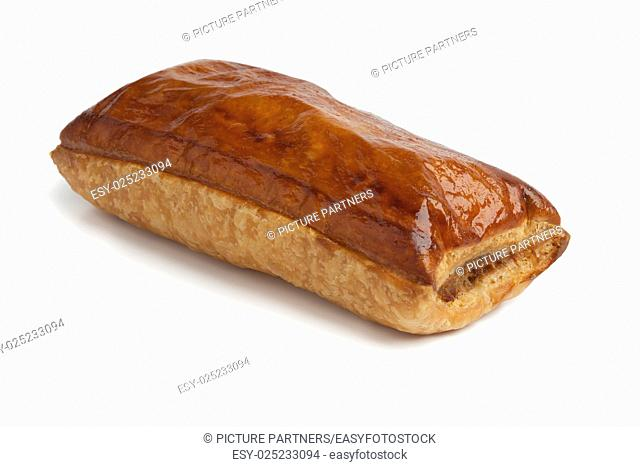 Fresh baked whole sausage roll on white background