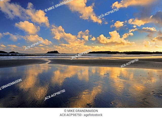 Clouds reflected in the Pacific Ocean at sunrise on Mackenzie Beach Pacific Rim NAtional Park British Columbia Canada