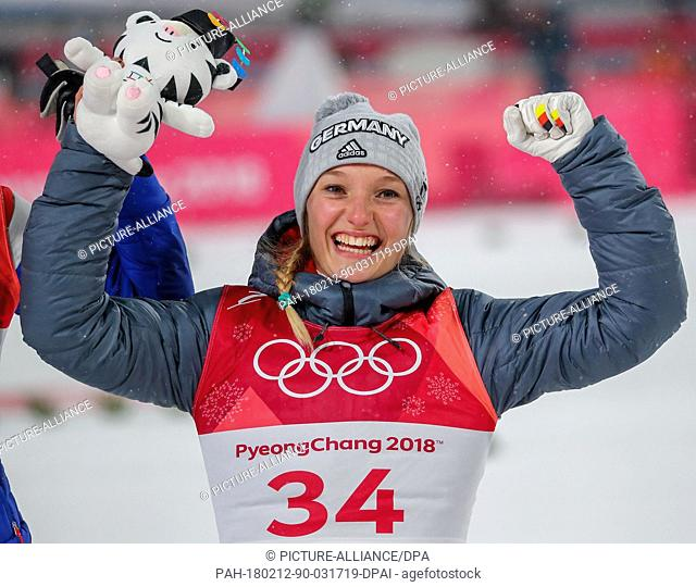 Germany's Katharina Althaus celebrates winning the silver medal at the women's ski jumping event at Alpensia Ski Jump Centre during the Olympic Winter Games in...