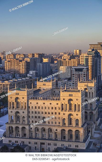Azerbaijan, Baku, high angle skyline with Dom Soviet Government House, dusk