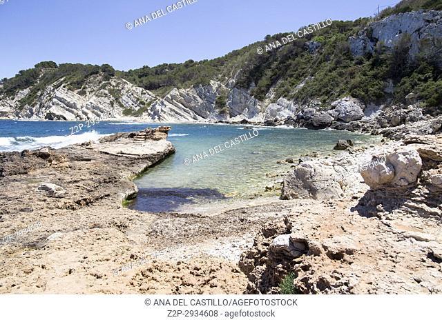 Rocky coast in Cala Blanca Javea Alicante. Spain