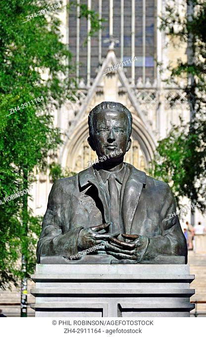 Brussels, Belgium. Bust of King Baudouin (1951-93) in front of the Cathedral of St. Michael and St. Gudula (1519: Gothic)
