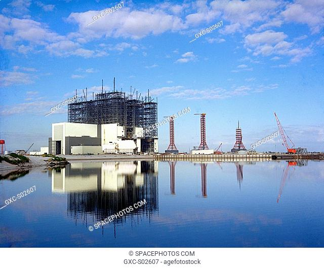 Complex 39 reflection shot of the Vehicle Assembly Building VAB under construction with the Launch Control Center LCC and Service Towers as seen from across the...