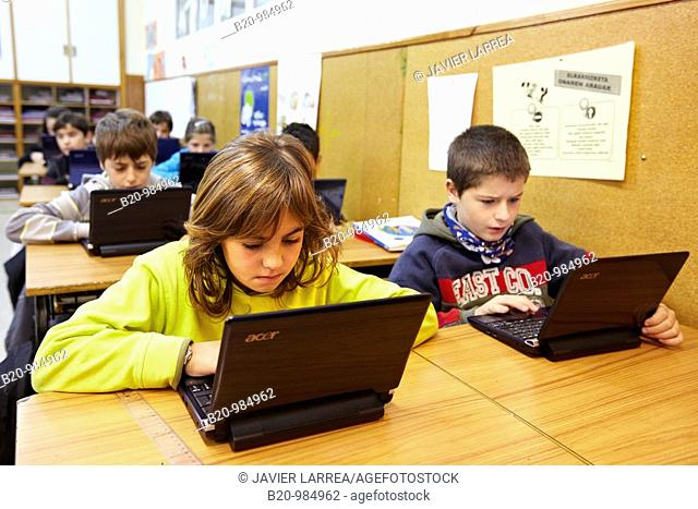 11 year old pupils using laptop computers, 5º de ESO, Ikastola Zurriola, San Sebastian, Guipuzcoa, Basque Country, Spain