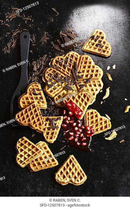 Waffles with grated chocolate and pomegranate seeds (seen from above)