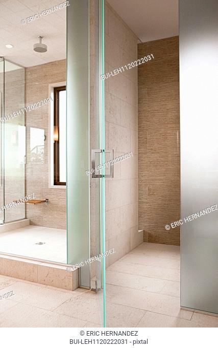 Open door besides shower at home; Newport Beach; California; USA