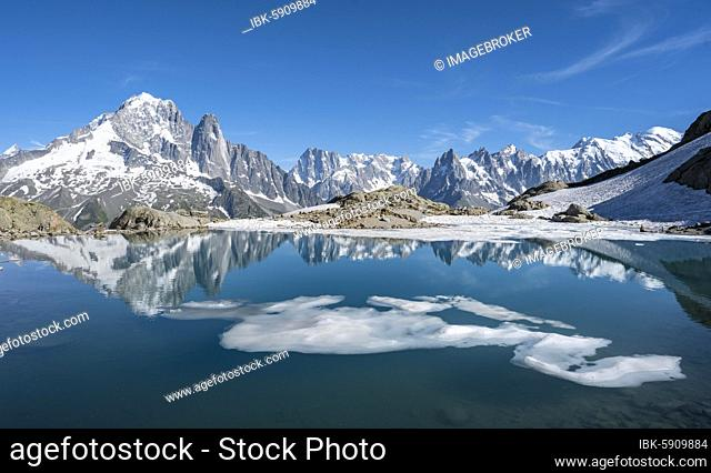 Mountain panorama, ice floe on Lac Blanc, mountain peaks reflected in mountain lake, Grandes Jorasses and Mont Blanc massif, Chamonix-Mont-Blanc, Haute-Savoie