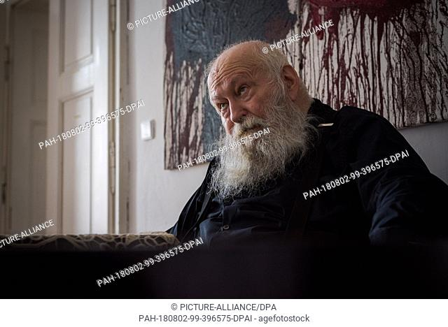 01 August 2018, Austria, Prinzendorf an der Zaya: The Austrian painter and action artist Hermann Nitsch sits in front of one of his action paintings at...