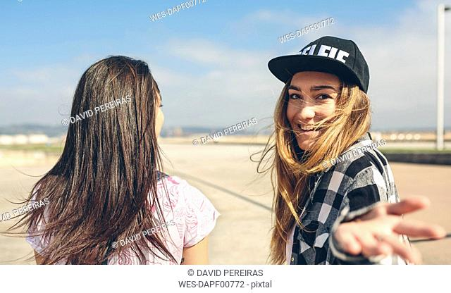 Two young women on beach promenade