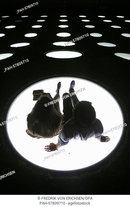 Two visitors sit on the illuminated skylights of the Staedel Museum in Frankfurt am Main, Germany, 25 April 2015. Ten thousand visitors were expected for the...
