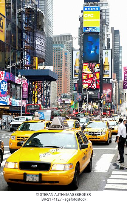 Metropolis, high-rise buildings and bright neon avertising signs, yellow cabs, taxis, intersection of Broadway and 7th Avenue, Times Square, Midtown, Manhattan