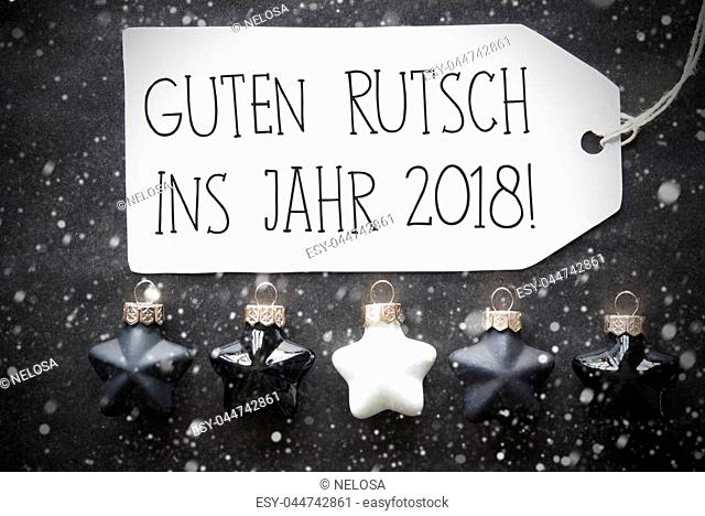 Label With German Text Guten Rutsch Ins Jahr 2018 Means Happy New Year 2018. Black And White Christmas Tree Balls On Black Paper Background With Snowflakes