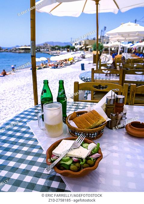 Greek salad on table. Beach side restaurant. Island of Rhodes Greece