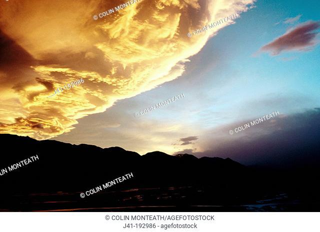 Sunset on clouds over Rakaia River. New Zealand