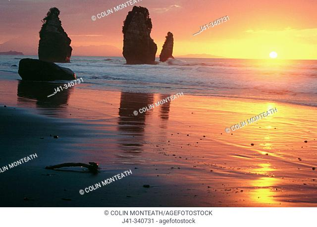The Three Sisters at sunset, Tongaporutu, North Taranaki. South Island. New Zealand