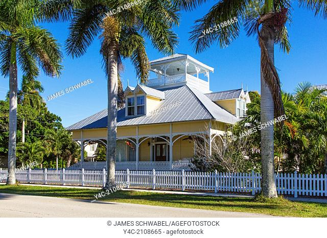 American Craftman bungalow house amoung tropical palm trees in Punta Gorda Florida