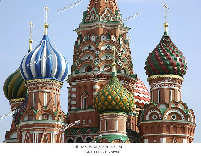 A church having colorful steeples with a cross on each one of them, Moscow
