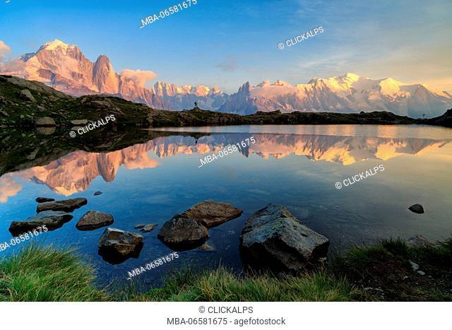 m, blanc and an hiker mirrored on lake of Cheserys, chamonix, france, europe