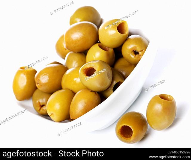 Green olives over white background