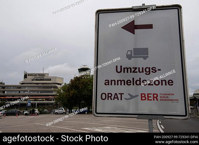 "27 September 2020, Berlin: A sign saying """"Umzugsanmeldezone"""" is located in front of Tegel Airport. The opening date of the new BER airport is scheduled for 30..."